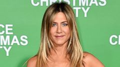 Jennifer Aniston Hits the Red Carpet for Office Christmas Party