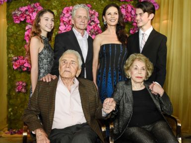 PHOTO: Kirk Douglas holds hands with his wife Anne Douglas, as they pose with family members, Michael, Catherine Zeta-Jones, Carys Zeta Jones and Dylan during Kirks 100th birthday party, Dec. 9. 2016, in Beverly Hills, California.