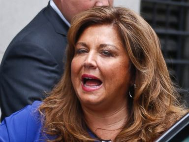 PHOTO: Dance Moms star Abby Lee Miller gets into an awaiting vehicle after leaving federal court and pleading guilty in Pittsburgh, June 27, 2016, to bankruptcy fraud.