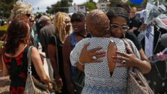 PHOTO: Rita Washington, facing at right, daughter of B.B. King, embraces mourners waiting in line during a public viewing of the blues legend Friday, May 22, 2015, in Las Vegas. King died last week at 89.