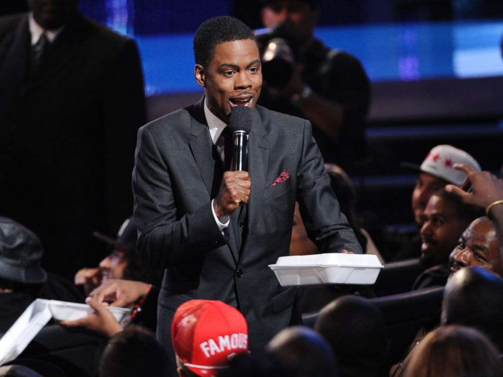PHOTO: Host Chris Rock hands out fried chicken and waffles at the BET Awards at the Nokia Theatre, June 29, 2014, in Los Angeles.