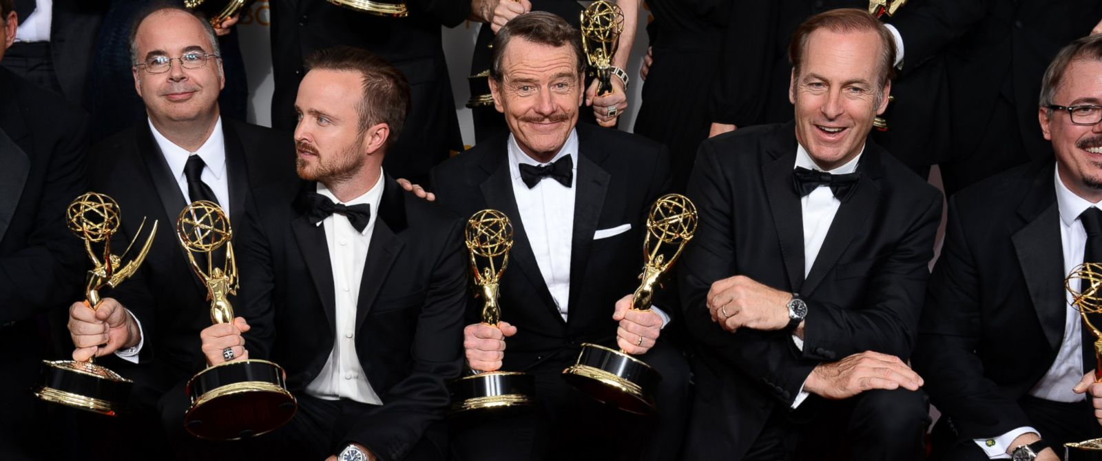 "PHOTO: Co-executive producer Thomas Schnauz, from left, Aaron Paul, Bryan Cranston and Bob Odenkirk pose in the press room with the award for outstanding drama series for ""Breaking Bad"" at the 66th Annual Primetime Emmy Awards."