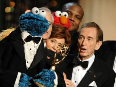 PHOTO: Bob McGrath, right, looks at the Cookie Monster as the accept the Lifetime Achievement Award for Sesame Street at the Daytime Emmy Awards, Aug. 30, 2009, in Los Angeles.