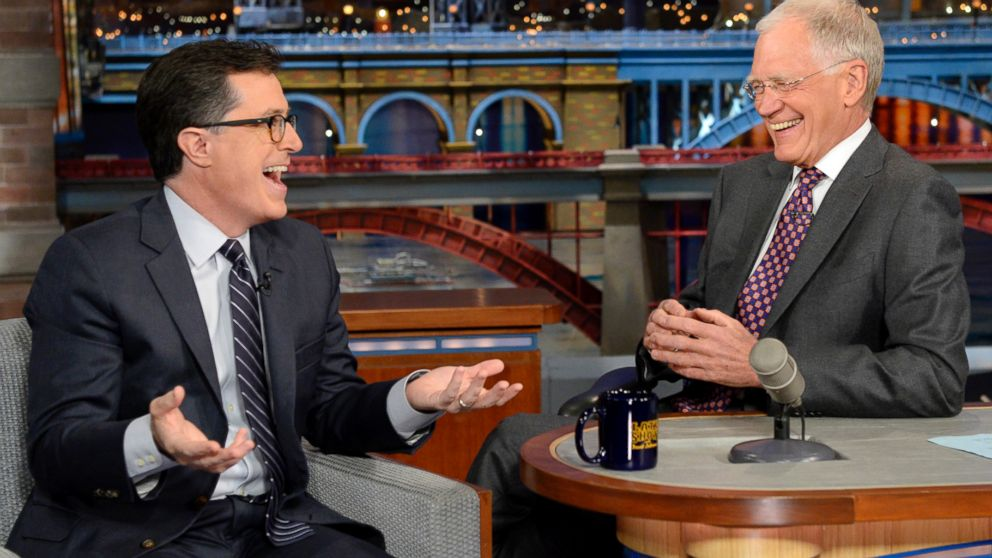 "PHOTO: Stephen Colbert, left, joins host David Letterman on the set of ""Late Show with David Letterman,"" April 22, 2014, in New York."