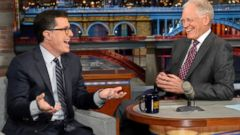 PHOTO: Stephen Colbert, left, joins host David Letterman on the set of Late Show with David Letterman, April 22, 2014, in New York.