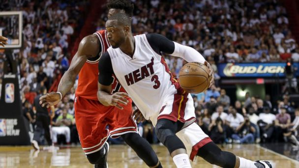 PHOTO: Dwyane Wade goes around Chicago Bulls guard Jimmy Butler during an NBA basketball game in Miami, April 7, 2016.