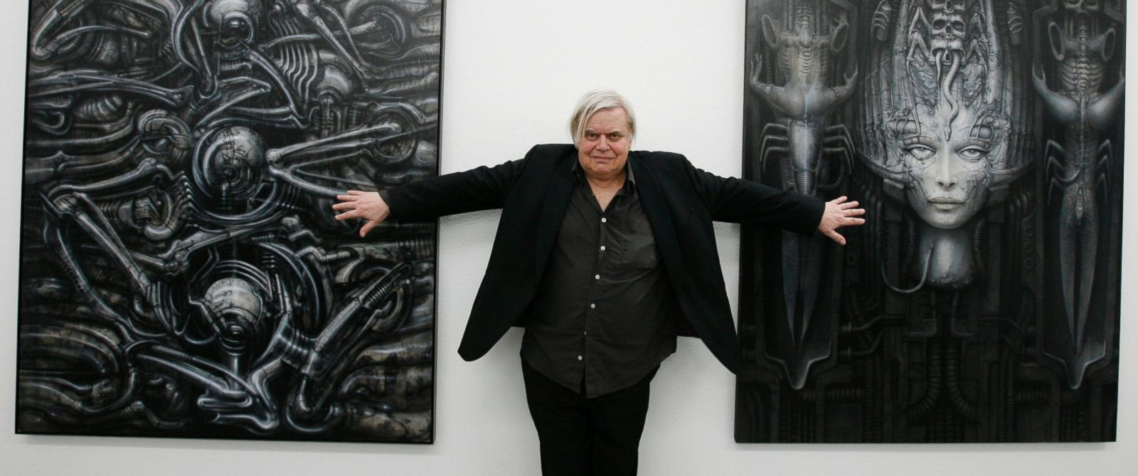 PHOTO: In this June 29, 2007 file picture Swiss artist H.R. Giger poses with two of his works at the art museum in Chur, Switzerland.