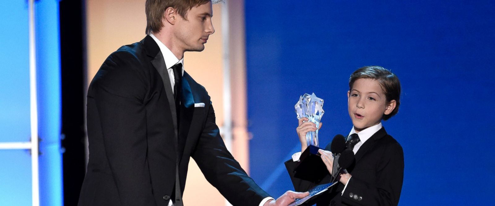 PHOTO: Bradley James, left, holds the microphone for Jacob Tremblay as he accepts the award for best young actor/actress for ?Room? at the 21st annual Critics Choice Awards at the Barker Hangar on Jan. 17, 2016, in Santa Monica, Calif.