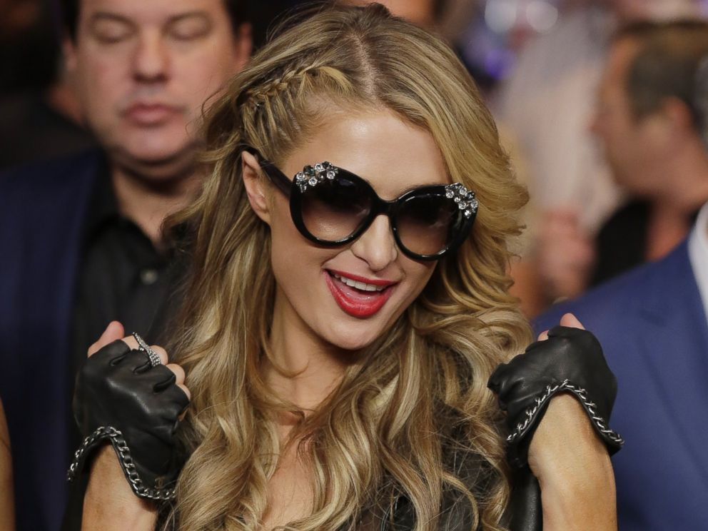 PHOTO: Paris Hilton enters the arena before the start of the world welterweight championship bout between Floyd Mayweather Jr., and Manny Pacquiao, on Saturday, May 2, 2015 in Las Vegas.