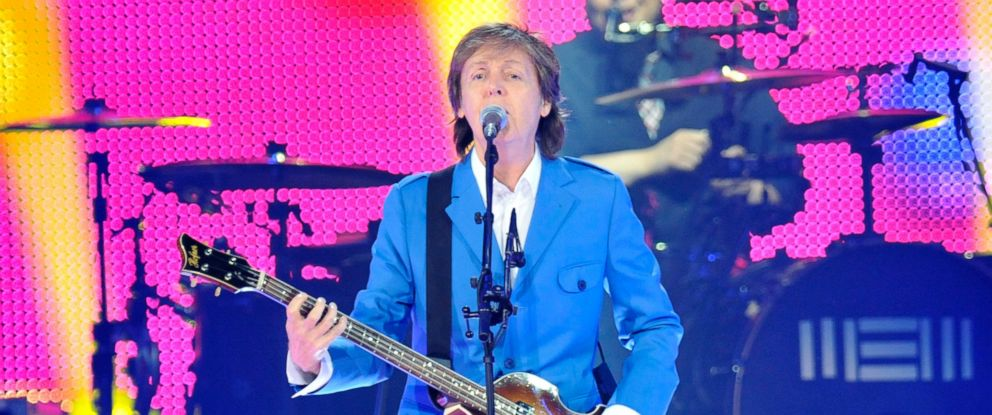 """PHOTO: Sir Paul McCartney performs with his band during the ?Out There"""" Tour at the Times Union Center, July 5, 2014, in Albany, N.Y."""