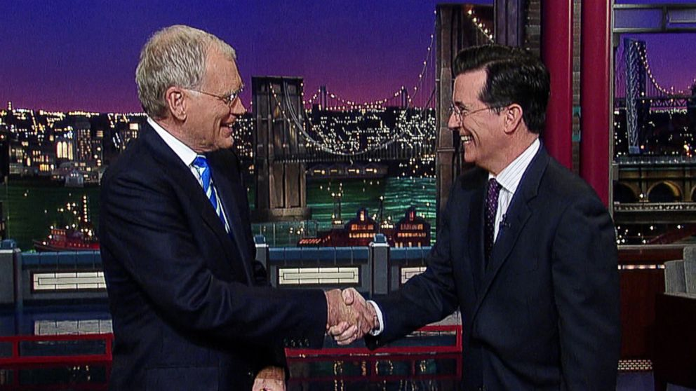 "PHOTO: This May 4, 2011 image from video released by CBS shows host David Letterman, left, shaking hands with fellow talk show host Stephen Colbert of ""The Colbert Report,"" during a surprise visit on the ""Late Show with David Letterman,"" in New York."