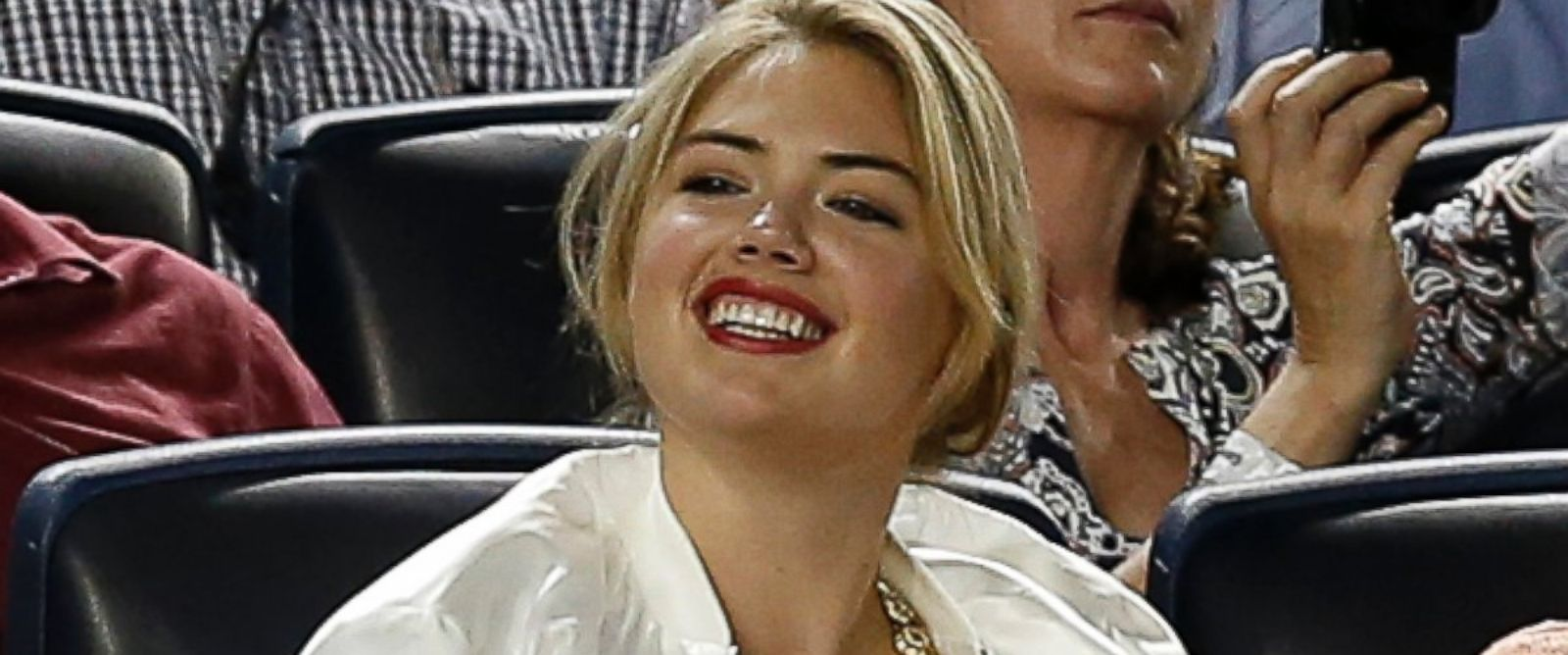 PHOTO: Supermodel Kate Upton smiles as she sits in the seats above the Detroit Tigers dugout in a baseball game between the Tigers and the New York Yankees at Yankee Stadium in New York, Aug. 4, 2014.
