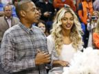 PHOTO: Jay-Z and Beyonce are pictured before the start of an NBA basketball game