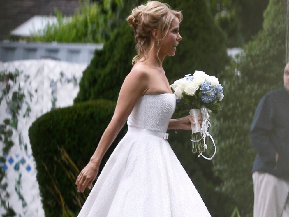 PHOTO: Actress Cheryl Hines walks across a lawn to the tent where her wedding to Robert F. Kennedy Jr., took place in Hyannis Port, Mass. on Aug. 2, 2014.