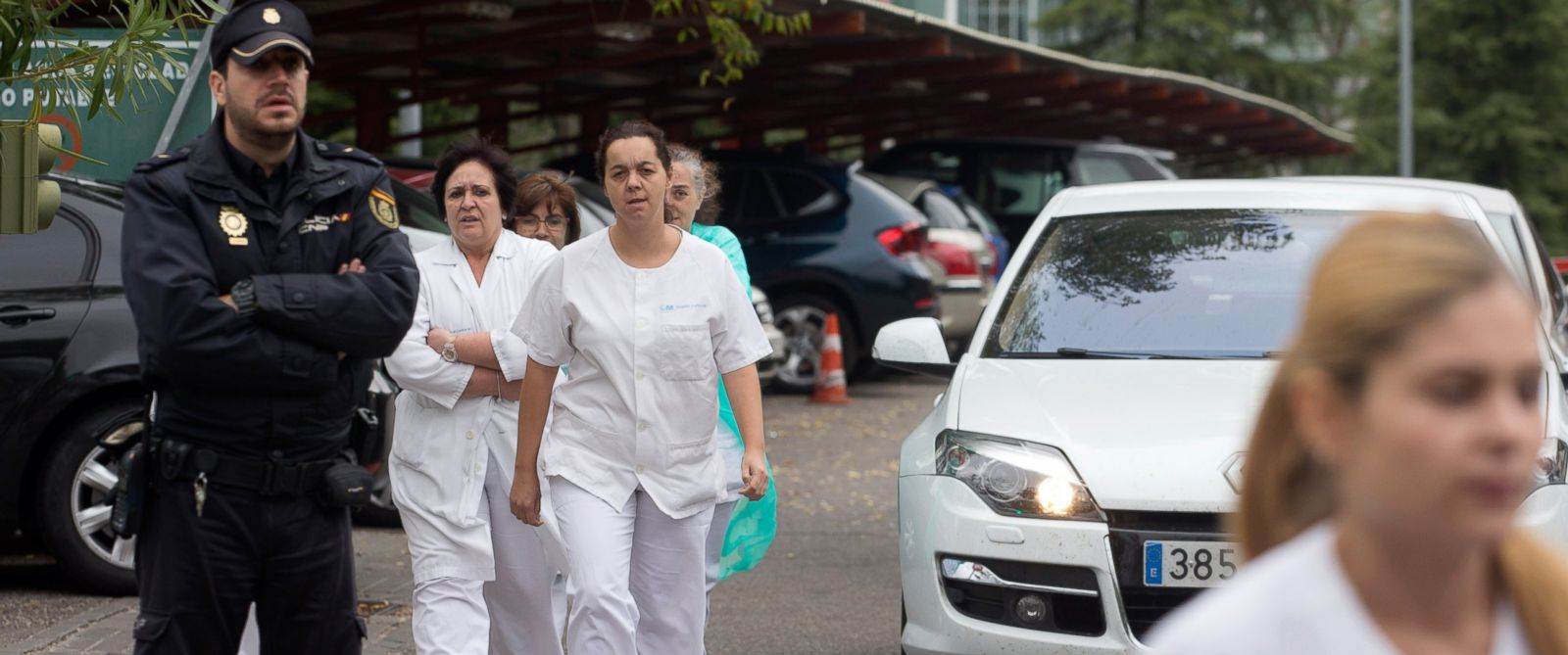 PHOTO: Hospital staff walk out past police guarding the entrance to a protest outside the Carlos III hospital in Madrid, Spain, Oct. 7, 2014, where a Spanish nurse who is believed to have contracted the ebola virus is being treated.