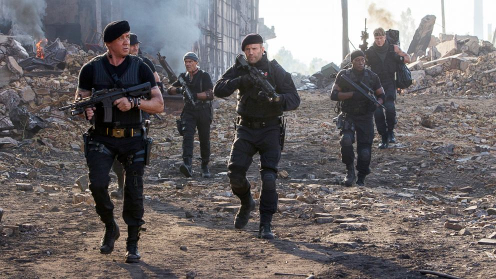 "PHOTO: Sylvester Stallone, left, and Jason Statham, center, in a scene from ""Expendables 3."""