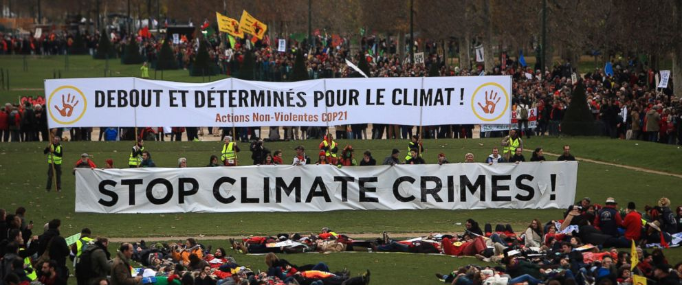 PHOTO: Activists gather during a demonstration near the Eiffel Tower, in Paris, Dec.12, 2015 during the COP21, the United Nations Climate Change Conference.
