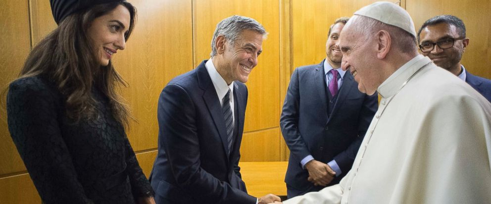 PHOTO: Pope Francis meets actor George Clooney and his wife Amal, at a meeting with the Scholas Occurrentes, an educational organization founded by Pope Francis, at the Vatican, May 29, 2016.