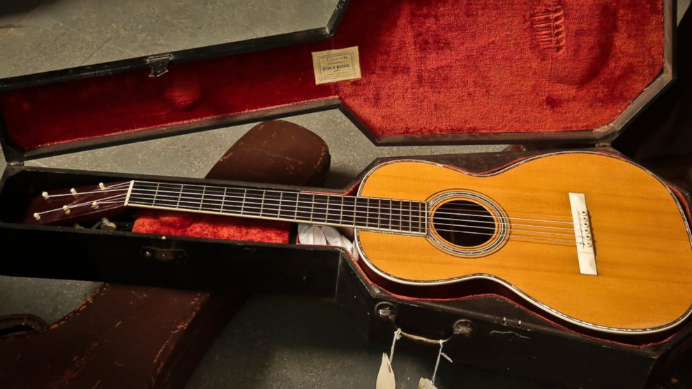 "PHOTO: A 1893 Martin guitar in a ""coffin"" case is unveiled during a press preview, March 5, 2014 in New York."