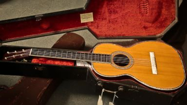 PHOTO: A 1893 Martin guitar in a coffin case is unveiled during a press preview, March 5, 2014 in New York.