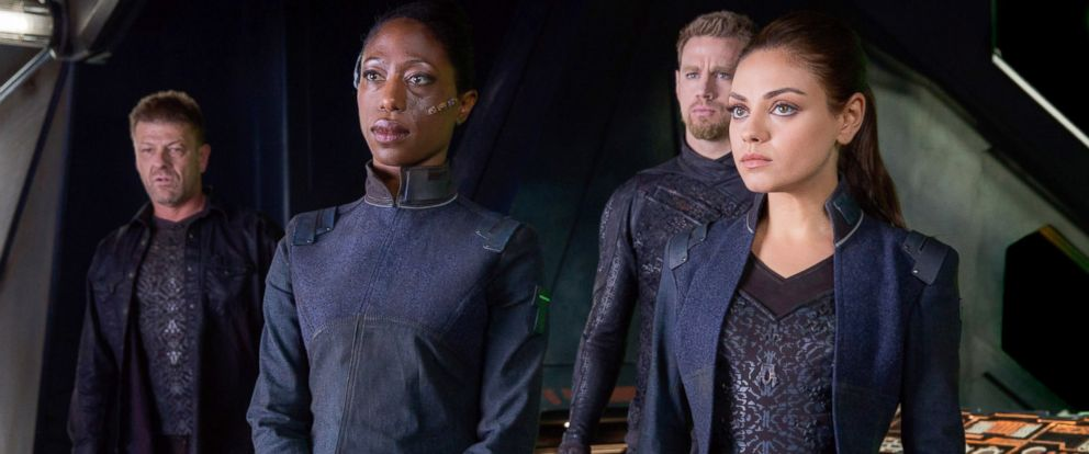 "PHOTO: Sean Bean as Stinger Apini, Nikki Amuka-Bird as Diomika Tsing, Channing Tatum as Caine Wise and Mila Kunis as Jupiter Jones in Warner Bros. Pictures and Village Roadshow Pictures ""Jupiter Ascending."""