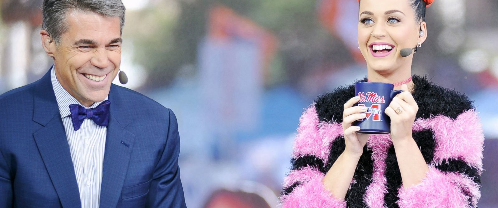 PHOTO: Katy Perry, right, joins host Chris Fowler, left, during telecast of ESPNs College GamDay in The Grove at the University of Mississippi prior to their NCAA college football game in Oxford, Miss., Oct. 4, 2014.