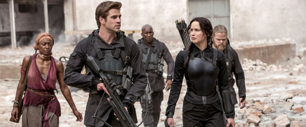 "PHOTO: Jennifer Lawrence portrays Katniss Everdeen, right, and Liam Hemsworth portrays Gale Hawthorne in a scene from ""The Hunger Games: Mockingjay Part 1."""