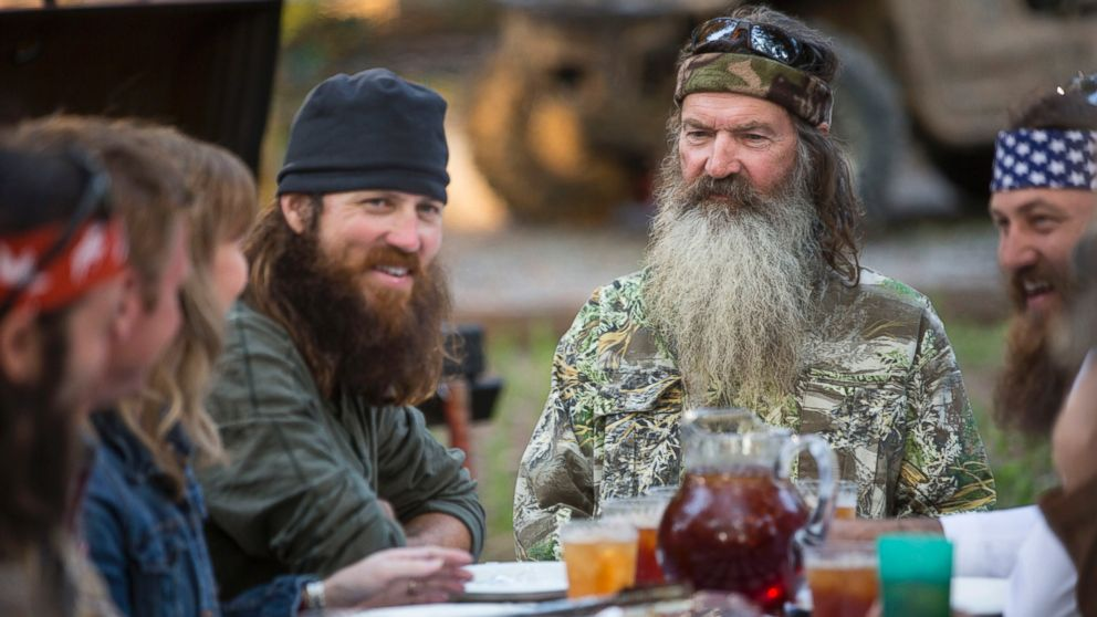 "PHOTO: This undated image released by A&E shows Phil Robertson, flanked by his sons Jase Robertson, left, and Willie Robertson from the popular series ""Duck Dynasty."""