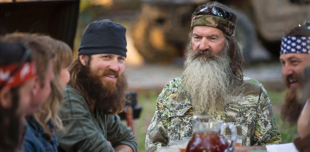 """PHOTO: This undated image released by A&E shows Phil Robertson, flanked by his sons Jase Robertson, left, and Willie Robertson from the popular series """"Duck Dynasty."""""""
