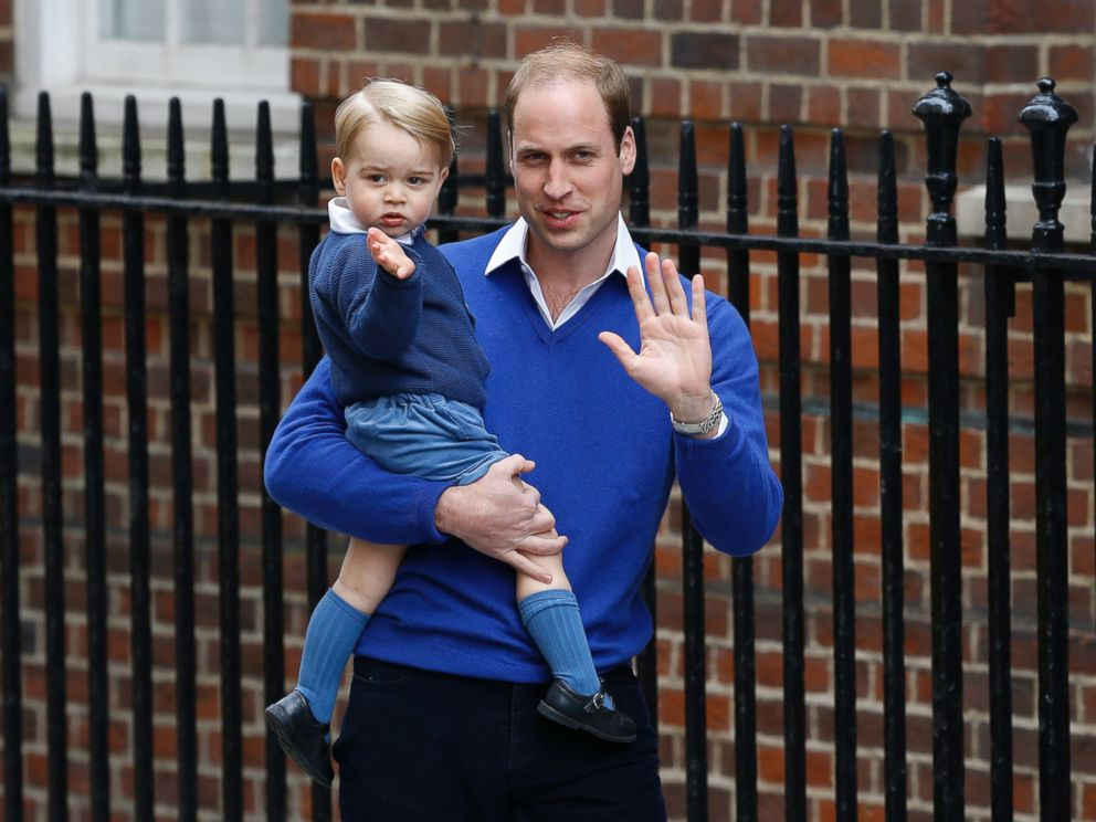 PHOTO: Britains Prince William and his son Prince George wave as they return to St. Marys Hospitals exclusive Lindo Wing, London, Saturday, May 2, 2015.