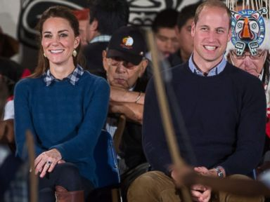 PHOTO: Britains Prince William, Duchess Kate and Governor General David Johnson, left, watch a performance during a welcoming ceremony at the Heiltsuk First Nation in the remote community of Bella Bella, British Columbia, Sept 26, 2016.