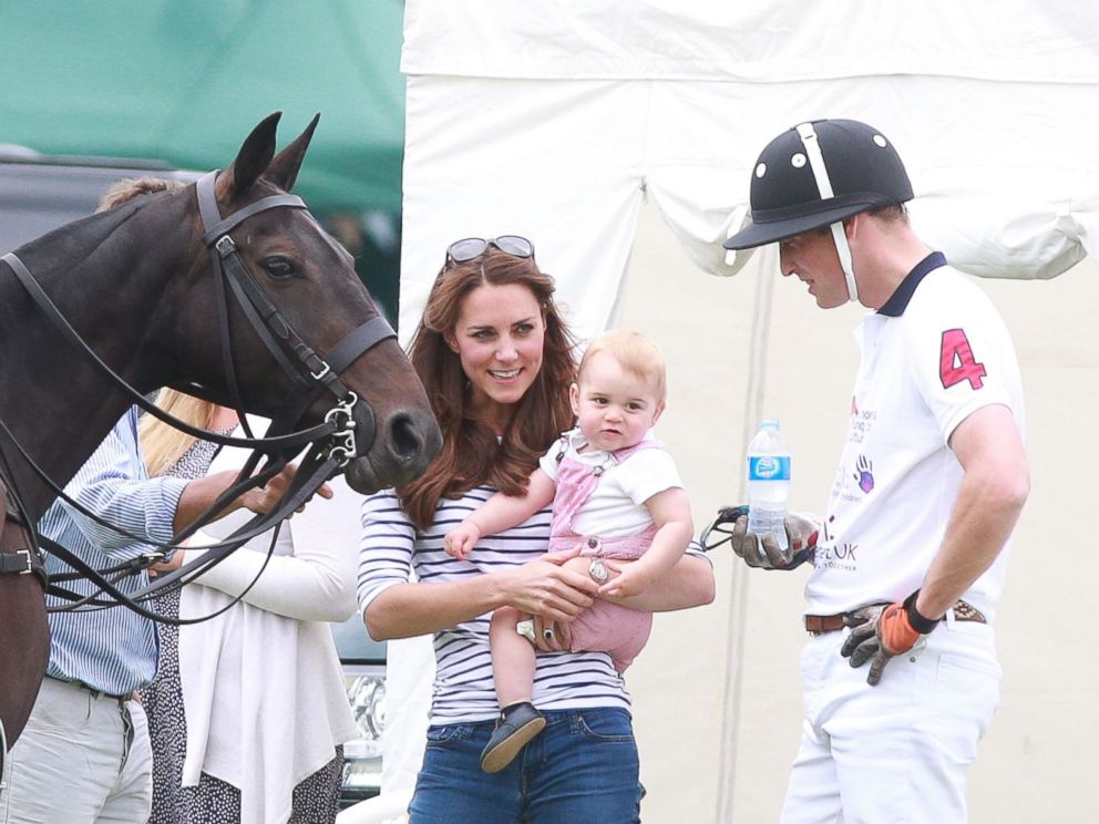 PHOTO: Prince William, Catherine Duchess of Cambridge and Prince George attend the Jerudong Trophy polo match at the Cirencester Polo Club in Gloucestershire, England, June 15, 2014.