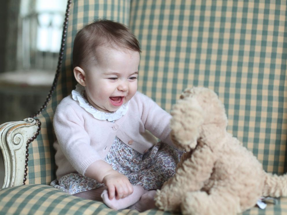 PHOTO: This undated photo released Nov. 29, 2015, by Britains Duke and Duchess of Cambridge, shows Princess Charlotte with her cuddly toy dog, at Anmer Hall in Sandringham, England.