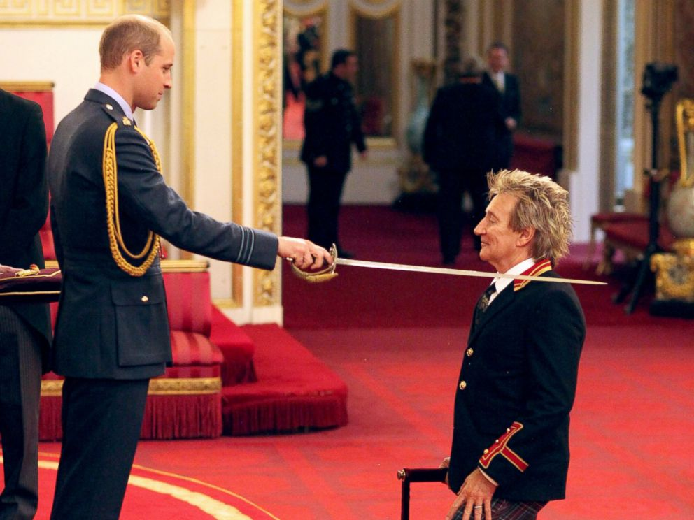 PHOTO: Sir Rod Stewart, right, is made a Knights Batchelor by Britains William, the Duke of Cambridge, during an Investiture ceremony at Buckingham Palace in London, Oct. 11, 2016.
