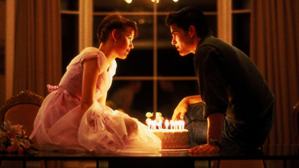 "PHOTO: Molly Ringwald, left, and Michael Schoeffling are shown in a scene from ""Sixteen Cancles"" in this 1984 film publicity image released by Universal Pictures."