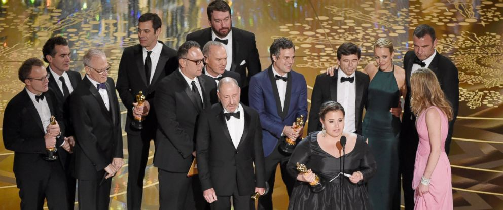 """PHOTO: Nicole Rocklin, foreground at podium, and the cast and crew of """"Spotlight,"""" accept the award for best picture at the Oscars, Feb. 28, 2016, in Los Angeles."""