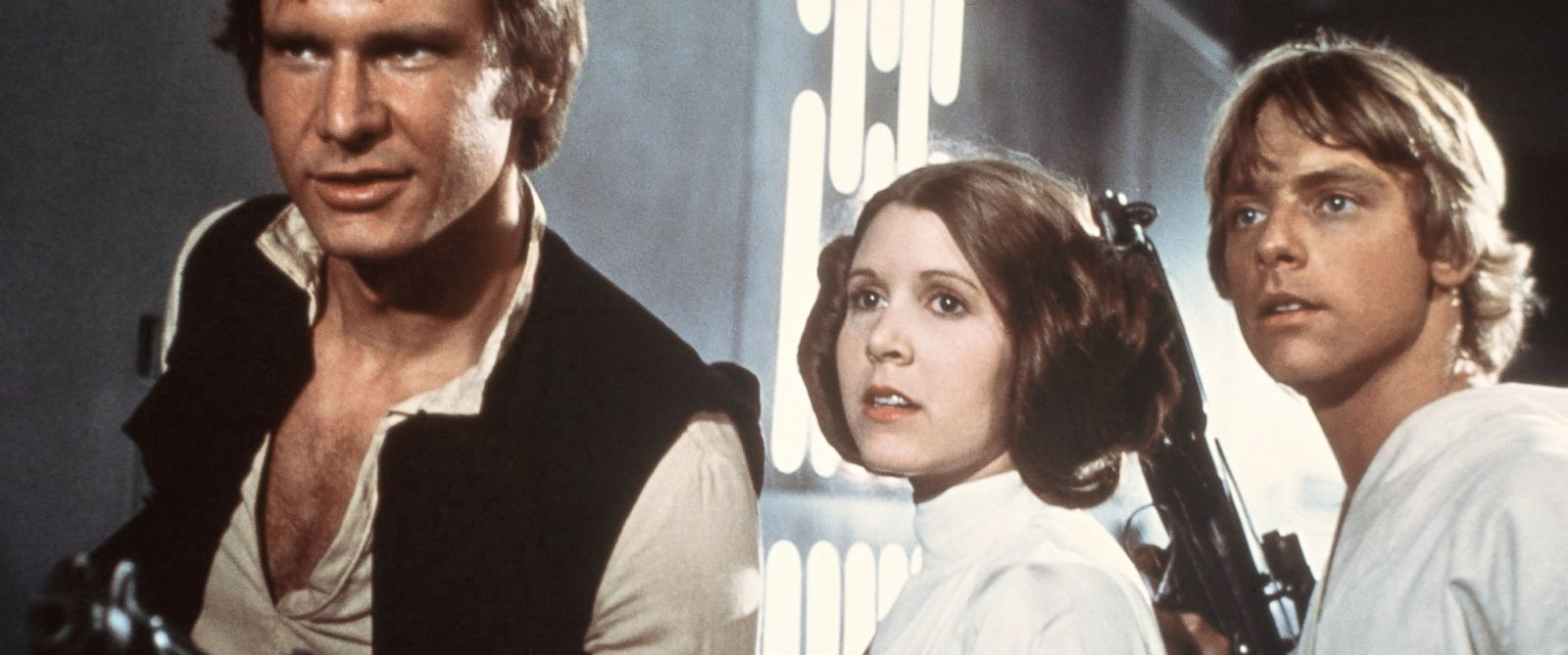 "PHOTO: From left, Harrison Ford, Carrie Fisher and Mark Hamill are pictured in a scene from ""Star Wars"" in 1977."