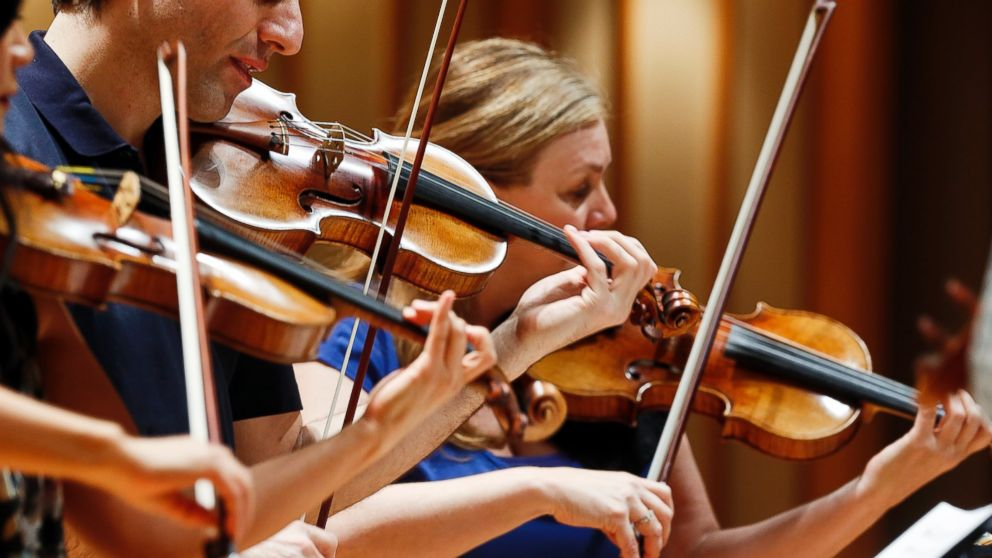 PHOTO: In this March, 27, 2014 photo, three violinists play Stradivarius violins during a rehearsal at the Colburn School in Los Angeles.