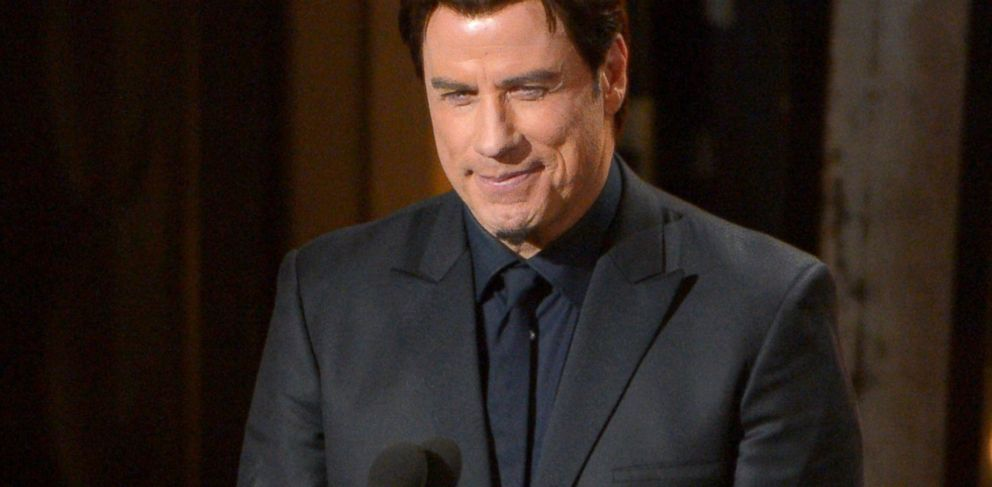 PHOTO: John Travolta speaks during the Oscars at the Dolby Theatre, March 2, 2014 in Los Angeles.