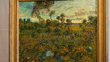 "PHOTO: Van Gogh Museum director Axel Ruger looks at ""Sunset at Montmajour"""