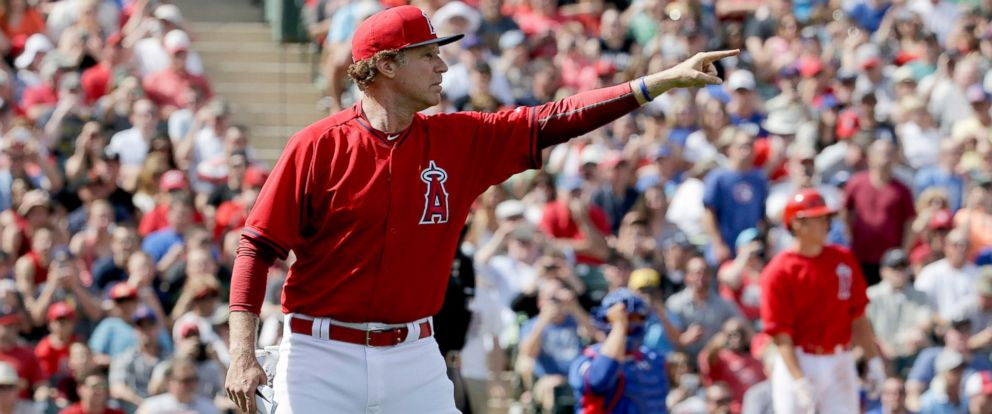PHOTO: Actor Will Ferrell dressed as a Los Angeles Angels player yells to ball players during a spring training baseball exhibition game against the Chicago Cubs in Tempe, Ariz., March 12, 2015.