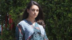 Mila Kunis Shows Off Growing Baby Bump
