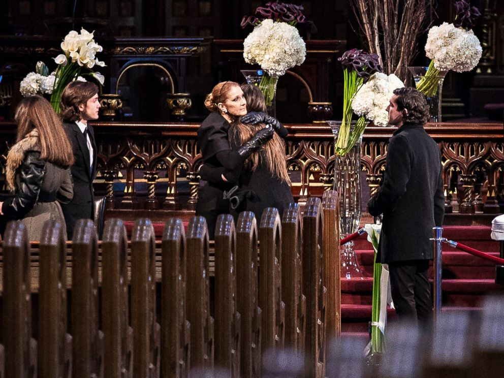 PHOTO: Celine Dion and family members observe as the priest conducts a memorial service before the public viewing for her husband Rene Angelil at Notre-Dame Basilica on January 21, 2016 in Montreal , Canada.