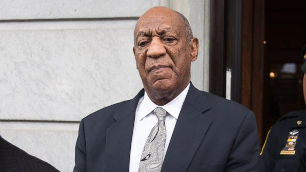 PHOTO: Actor and comedian Bill Cosby looks on as his publicist Andrew Wyatt addresses the media outside the Montgomery County Courthouse, June 17, 2017, in Norristown, Penn.