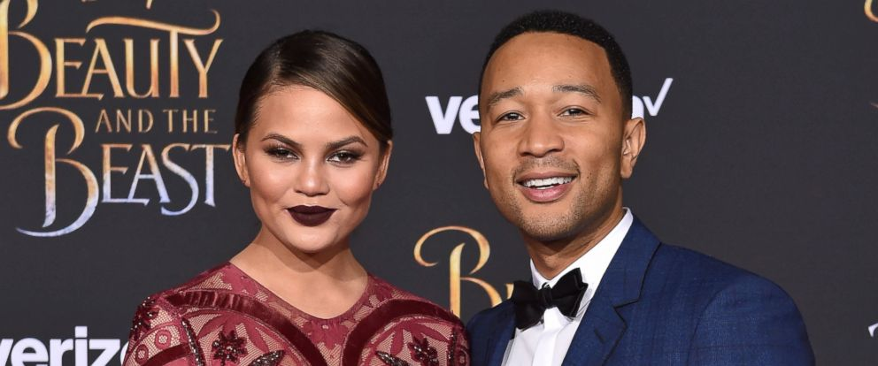 PHOTO: Model Chrissy Teigen and singer John Legend arrive at the Los Angeles Premiere of Beauty and the Beast at El Capitan Theatre, March 2, 2017, in Los Angeles.