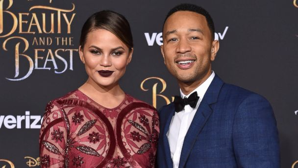 PHOTO: Model Chrissy Teigen and singer John Legend arrive at the Los Angeles Premiere of 'Beauty and the Beast' at El Capitan Theatre, March 2, 2017, in Los Angeles.