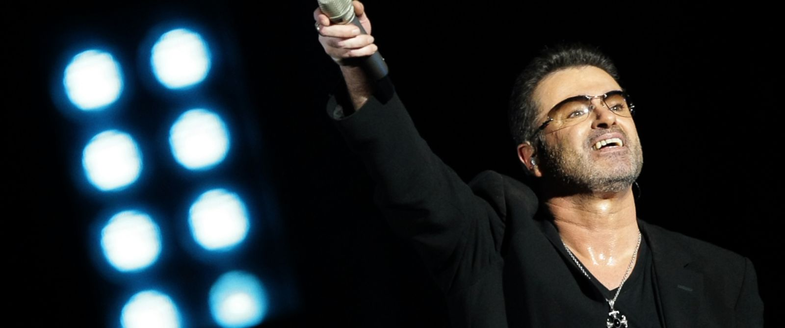 PHOTO: Pop singer George Michael performs in concert at the Zayed Sports City stadium, in Abu Dhabi, on Dec. 1, 2008.