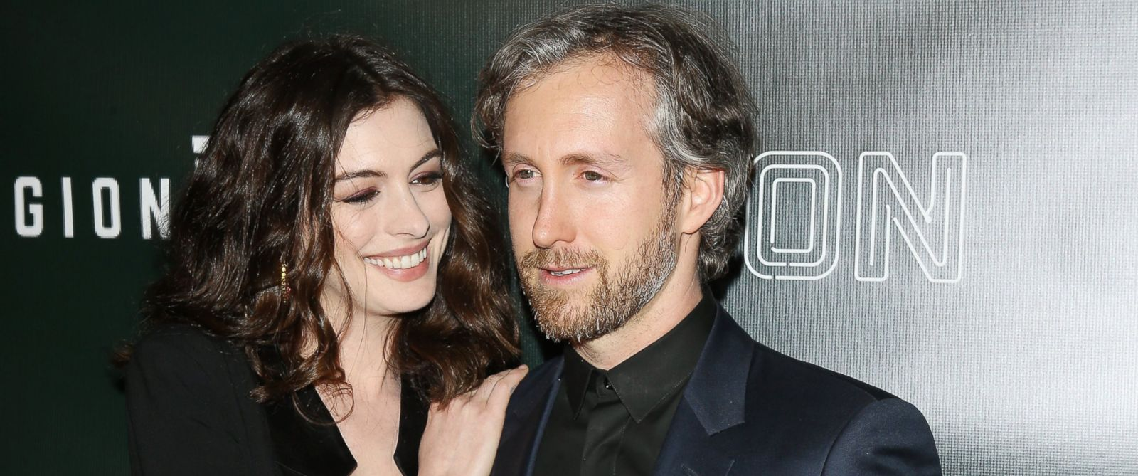 """PHOTO: Anne Hathaway with husand Adam Shulman arrive at the Los Angeles premiere of Neons """"Colossal"""" held at the Vista Theatre on April 4, 2017 in Los Angeles, California."""