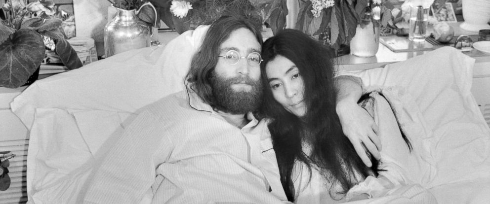 "PHOTO: Beatle John Lennon and Yoko Ono, pose in bed in Montreal, on June 1969. His first solo album at the time featured songs telling of his love for Yoko. They held an in bed press conferences in several cities with the theme, ""make love, not war."""