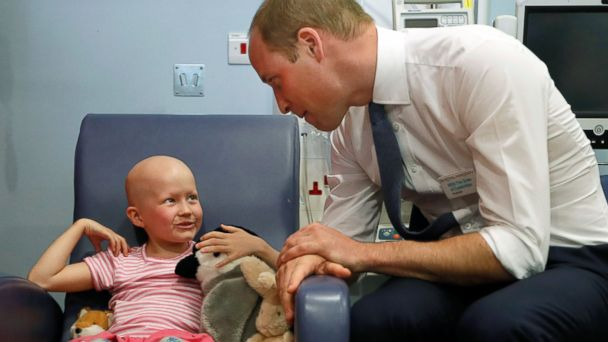 PHOTO: Britain's Prince William, Duke of Cambridge talks with patient Daisy Wood, 6, during a visit to the Royal Marsden hospital in Sutton, UK on May 16, 2017. The Duke of Cambridge is President of the Royal Marsden NHS Foundation Trust.